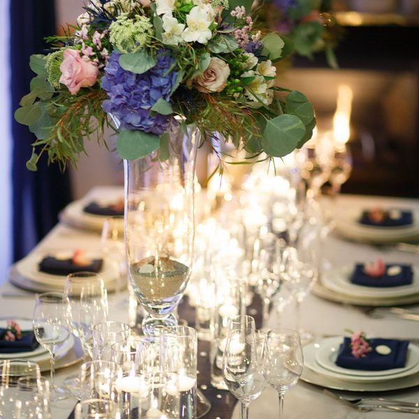 <p>Where Beach meets Country. Colour tones of grey, navy, soft pinks and pale yellows. Loaded with floating candle ambience.<br /> ©Delgado Photography</p>