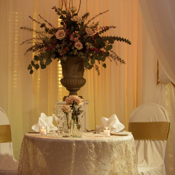<p>A Sweetheart Table made for two. Colour tones of gold, champagne, blush and pops of dark pink. Say romance!<br /> ©Etched Productions Professional Photography</p>